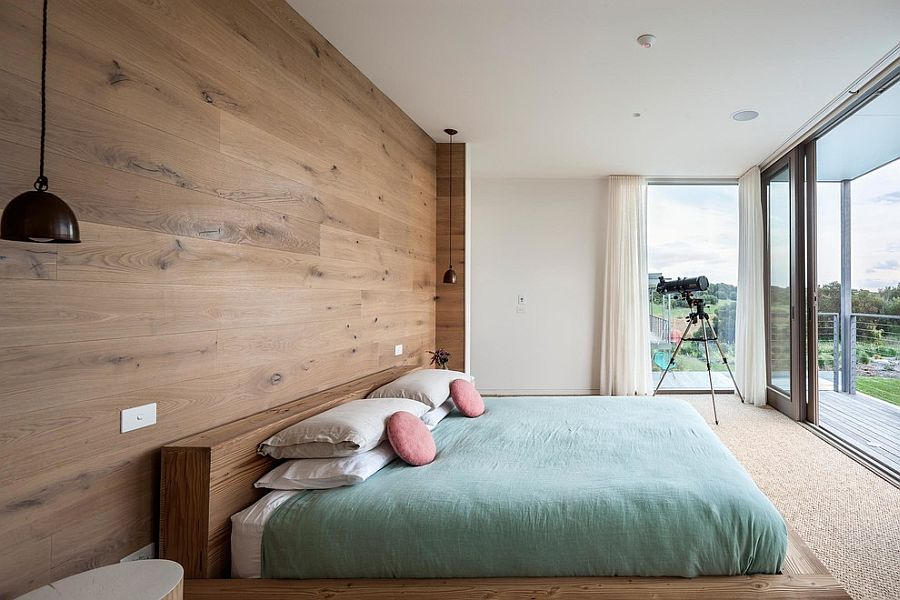 Lovely-bedroom-with-bedside-pendant-lights-and-wooden-headboard-wall
