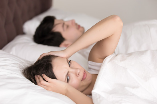 couple-bed-woman-suffering-from-insomnia-headache-snoring_1163-5245
