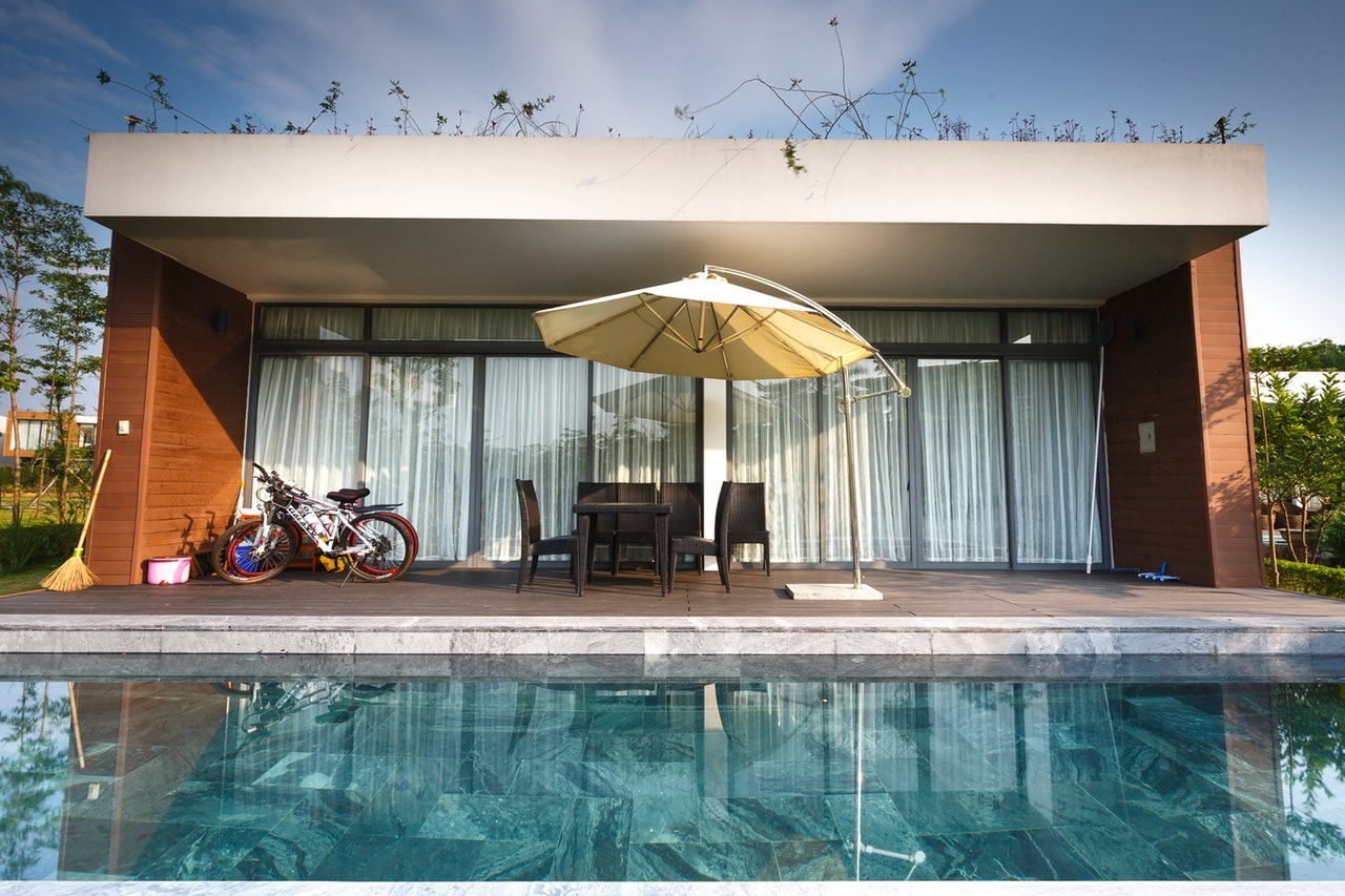 bikes-near-chairs-and-cantilever-parasol-2155202